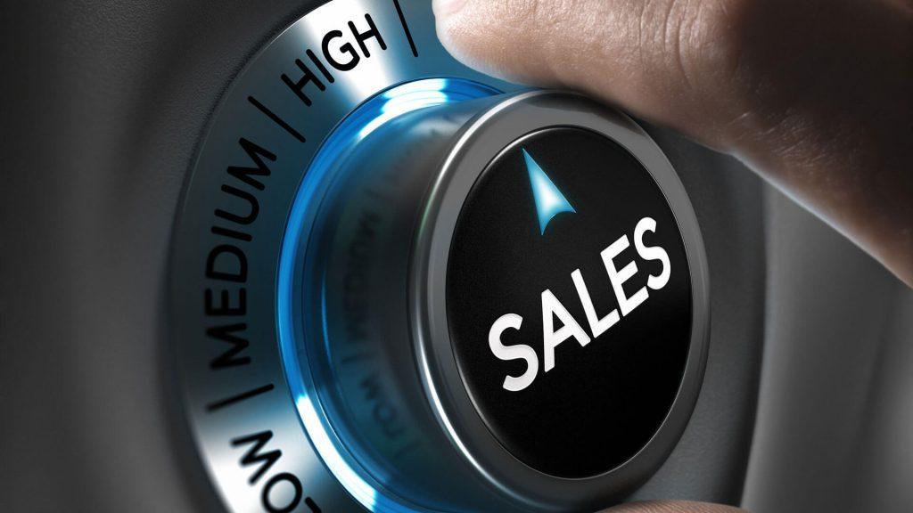 Man turning knob up that says sales